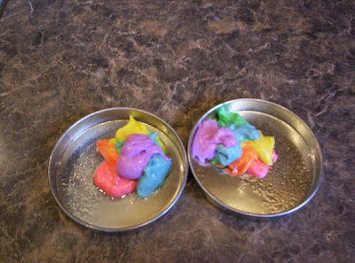 Fill The Two Baking Pans With Half Each Of Cake Batter Starting A Blop Red Then Orange Yellow Green Blue And Purple