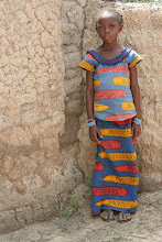 In Mali little girls wear dresses to school.