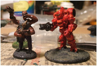 L to R: Peter Pig Large Green Martian (Traveller Sydite), Cyclops battle suit by Ground Zero Games