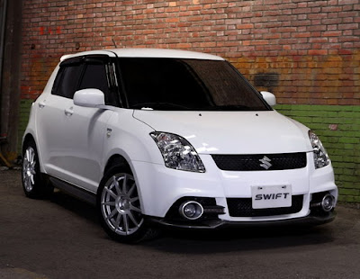 Suzuki Swift Hikary Bodykit. White Suzuki Swift with Hikary Bodykit