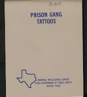 Cover of Prison Gang Tattoos booklet by Criminal Intelligence Service, Texas Department of Public Safety. Simple white cover with lettering in blue.