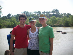 Eric, Me, and Amy in front of the watering hole, in front of elephants