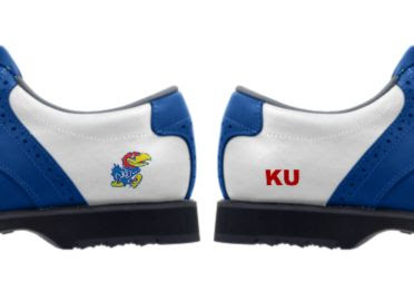 Blue KU golf shoes with logos of Big Jay the Jayhawk and red letters reading KU on a white background on lady's footwear with blue trim and black soles.