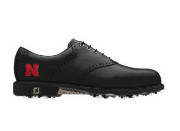 Black Nebraska Cornhuskers golf shoe with red letter N logo on the side of this Men's size 10 Footjoy product with black shoelaces and a black tongue.