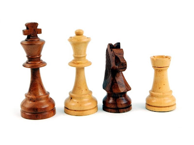 Chess set that could have been used on the show Lost because it's wood. The man in black would obviously cheat at chess if he could.
