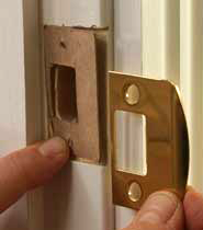 more than a 1/8-inch misalignment, remove the strike plate, and extend the mortise higher or lower as necessary.