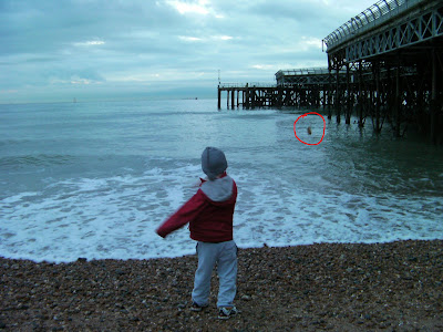 throwing shingle rocks into the sea