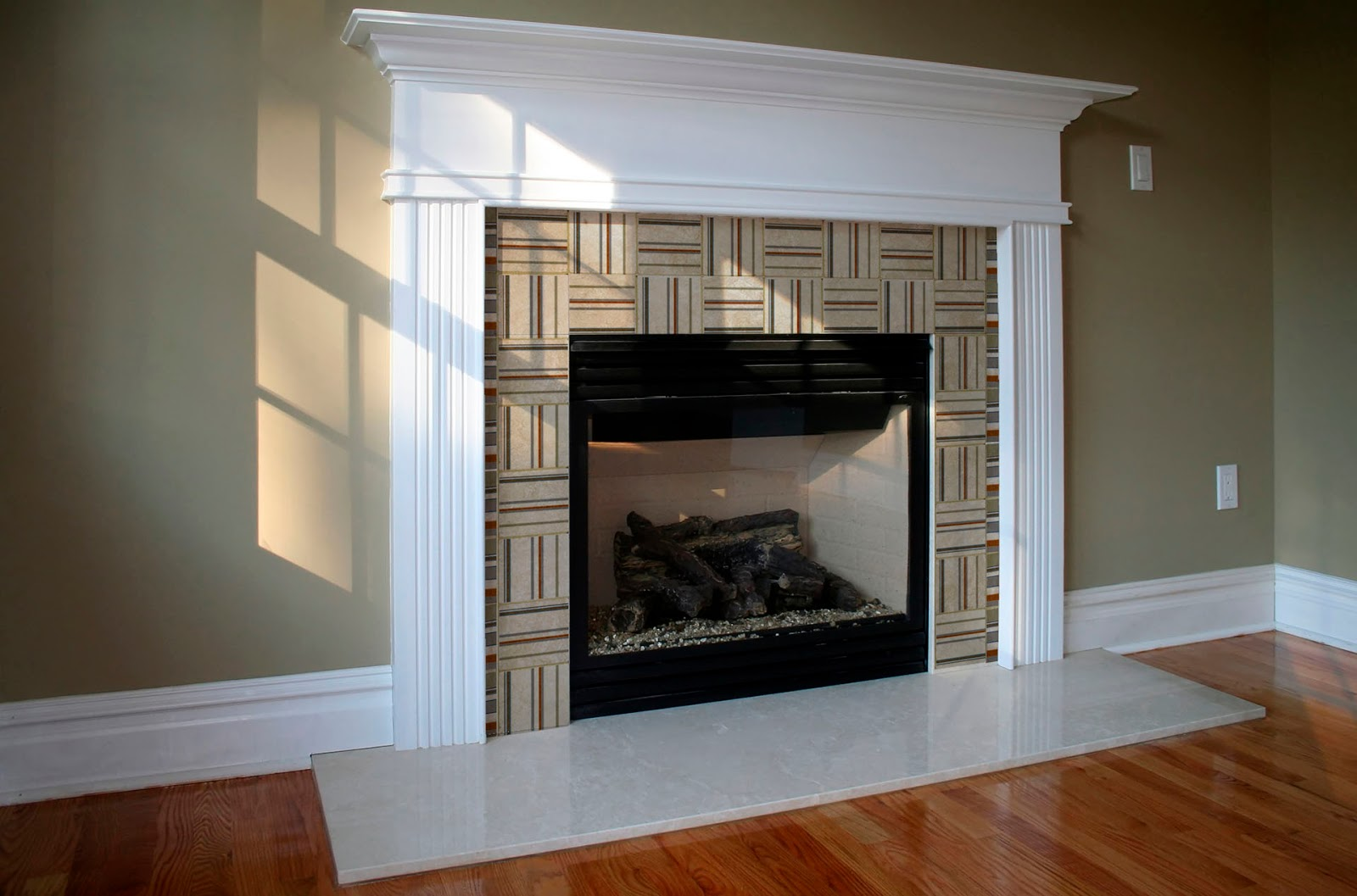 tiles from our modern collection used in a fireplace surround