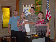 baby Logan w/mom (Amy) dad (Jason) & held by godparents Sarah & Bob.