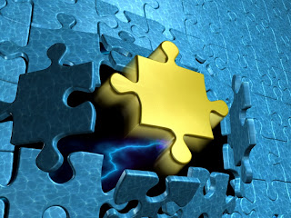 Picture of a puzzle with a golden piece