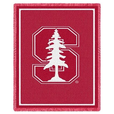 Stanford University Cardinal throw blanket that is red with white tree logo.