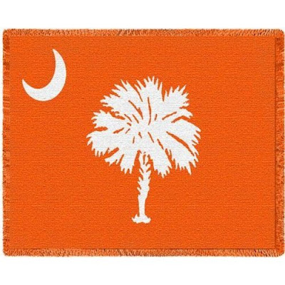Clemson University blanket that is South Carolina state flag colored orange.
