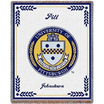 Pitt Panthers seal on a throw blanket that is white.