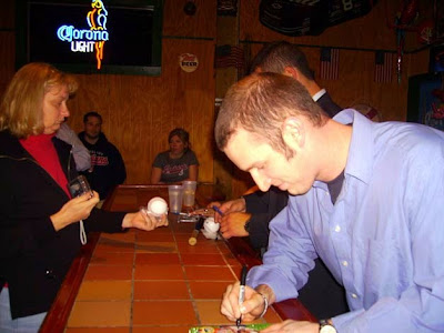 Jensen Lewis autographing my DVD of MAJOR LEAGUE at Stamper's Bar & Grill in Fairview Park during the Indians Press Tour — 24 January 2008 — Taken by Cathy