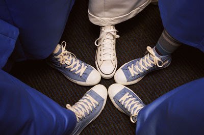 Walking around, dancing, and kung-fu fighting were all made super comfy by the standard uniform of Chucks.