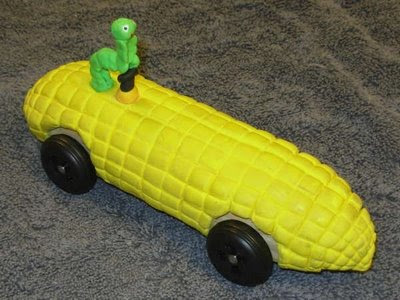 Photo: Corn on the Cob —  Carolyn H. built this corn on the cob car, and won the Third Place Unusual Design award in our 2007 Pathfinder/Trailblazer/Stockade race.