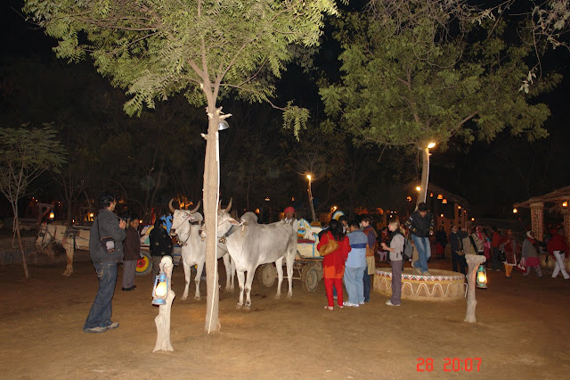 People waiting for bullock ride inside the tourist village of Chokhi Dhani