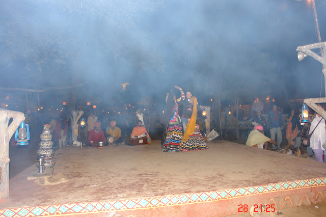 Artists at the Chokhi Dhani dancing, with a lot of smoke in the air (visible in the photo)