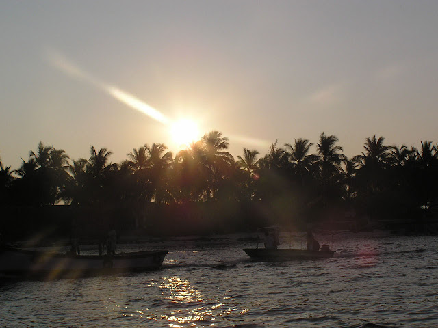 Photo of Sunrise over the Lakshadweep Islands in India, a beautiful view of the sun rays over palm and coconut trees