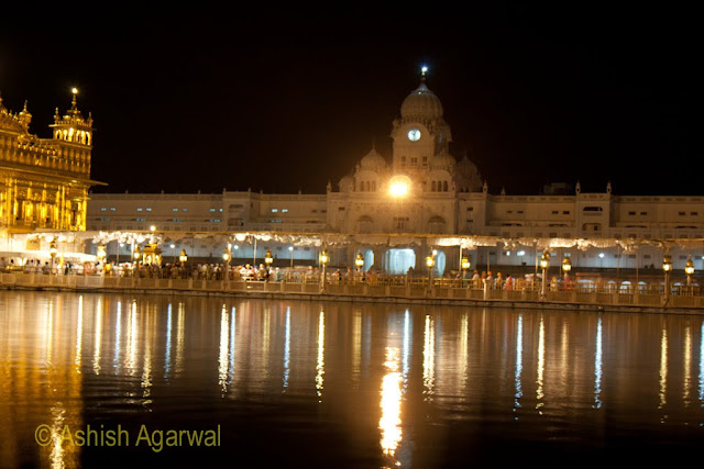 View of the Harmandir Sahib and the causeway with devotees inside the Golden Temple