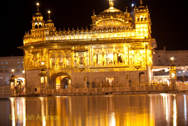 A close up photo of the Golden Temple in Amritsar at night