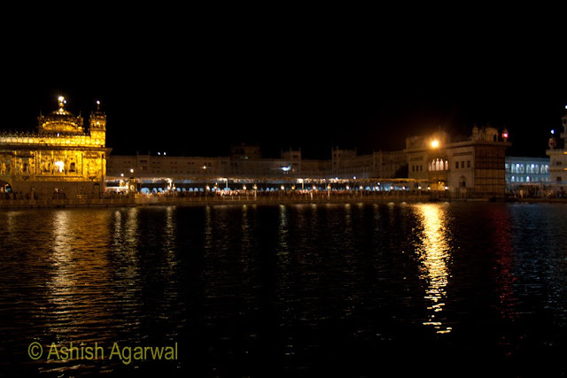 Much darker photo of the Golden Temple in Amritsar at night, with the exposure not being enough