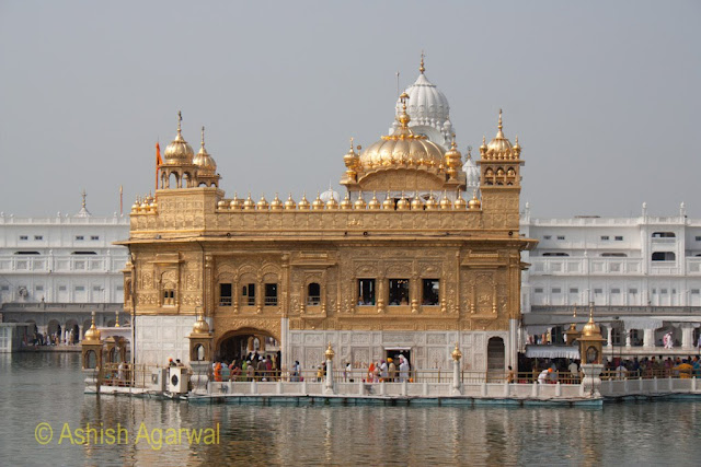The Golden structure of Harmandir Sahib in the middle of the holy sarovar in Amritsar