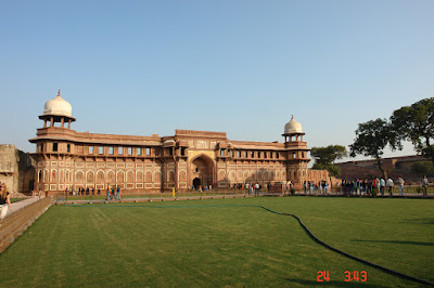 The front of the Agra Fort and its greenery
