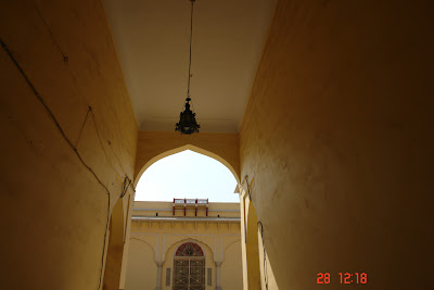 Arched doorway with a lamp