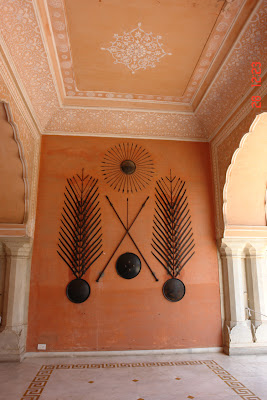 A lot of weapons mounted on the wall inside the Jaipur City Palace