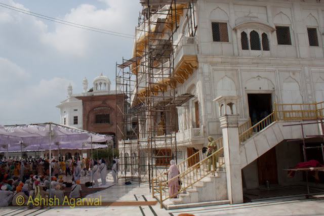 View of a congregation of devotees and the front of the Akal Takht in the Golden Temple complex in Amritsar