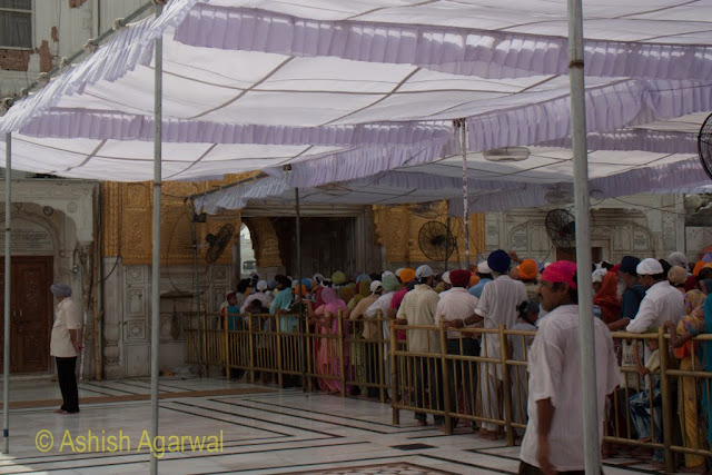 View of devotees queuing up at the Darshani Deori inside the Golden Temple in Amritsar