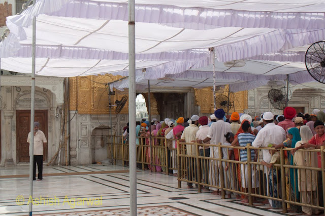 Closer view of the devotees in the queue just outside the Darshani Deori in the Golden Temple complex in Amritsar