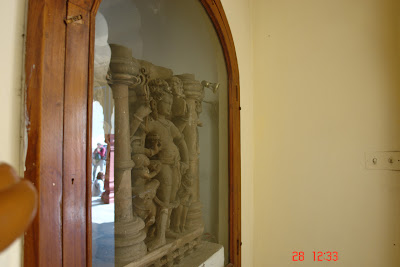 Side view of sculptures framed in a glass frame located inside the City Palace in Jaipur, India