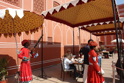 Photo of the Cafe of the Jaipur City Palace with waiters and tourists
