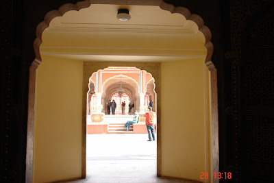 Photo of a view through a doorway, and into a bright courtyard