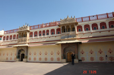 Photo of A solitary tourist taking a photo inside the Jaipur City Palace