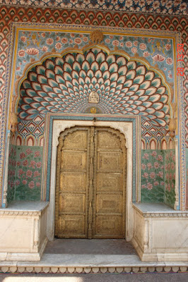 Slightly askew photo of a decorated door inside the Jaipur City Palace