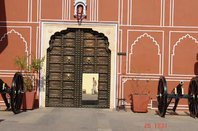 Photo of a Person framed in the open doorway inside the Jaipur City Palace