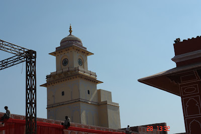 Photo of Clocktower in the Jaipur City Palace along with workmen working on a decoration
