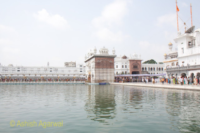 View of the Darshani Deori and caueway full of devotees inside the Golden Temple