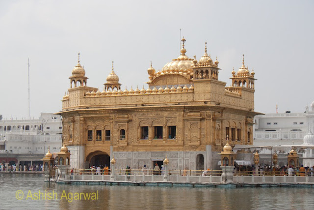 View of the Darbar Sahib along with a brief view of the causeway with devotees
