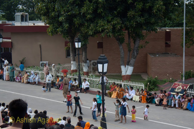 Children enjoying before a huge crowd on the Wagah border between India and Pakistan
