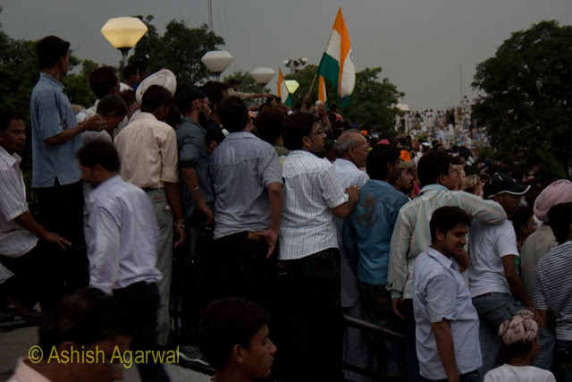 Crowd carrying Indian flags at the Wagah border between India and Pakistan, on the Indian side
