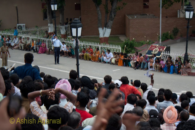 Man entertaining the crowd at the Wagah border flag lowering ceremony