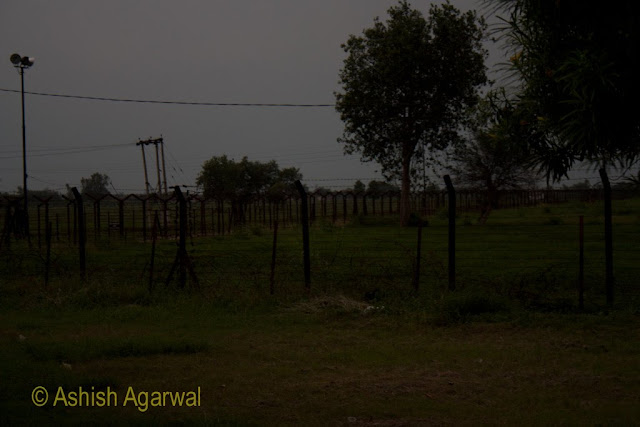 Barbed wire on either side of the way to the Wagah border between India and Pakistan