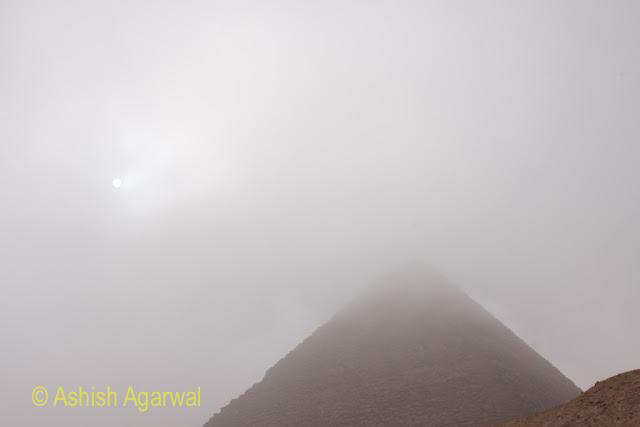 Cairo Pyramids - the sun visible through the fog