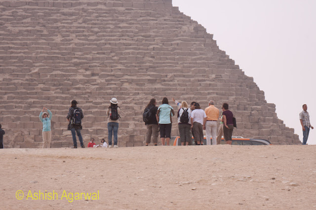 Cairo Pyramids - A view of tourists at the base of the Great Pyramid of Cheops