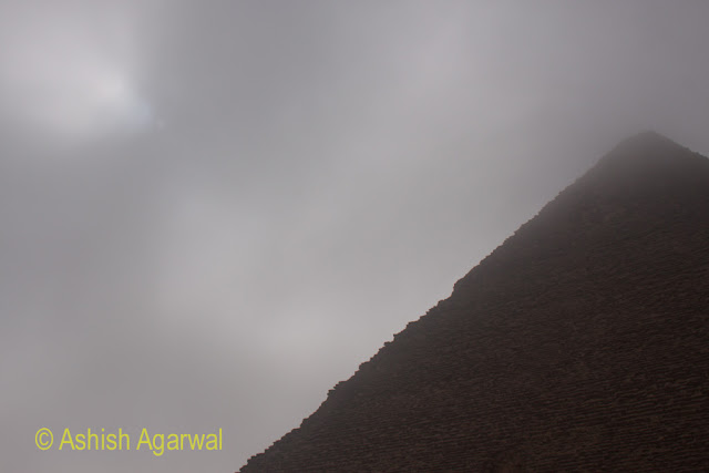 Cairo Pyramid - View of the slope of the Pyramid along with sun covered by fog