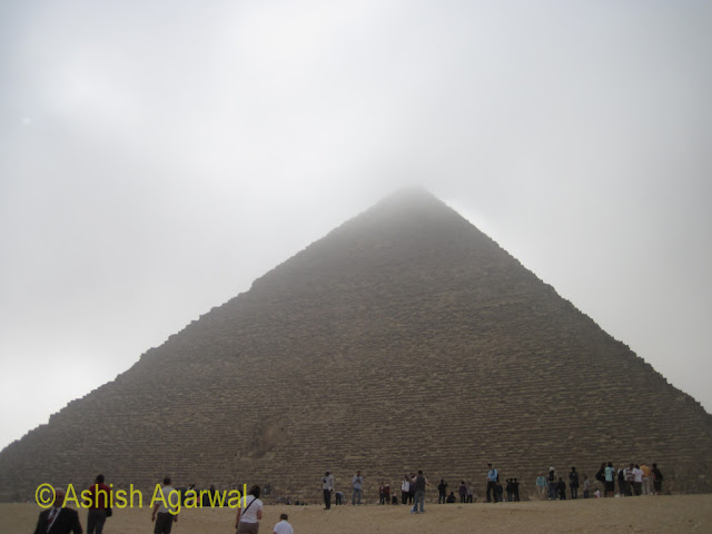 Cairo Pyramid - A view of the Great Pyramid with fog covering the top